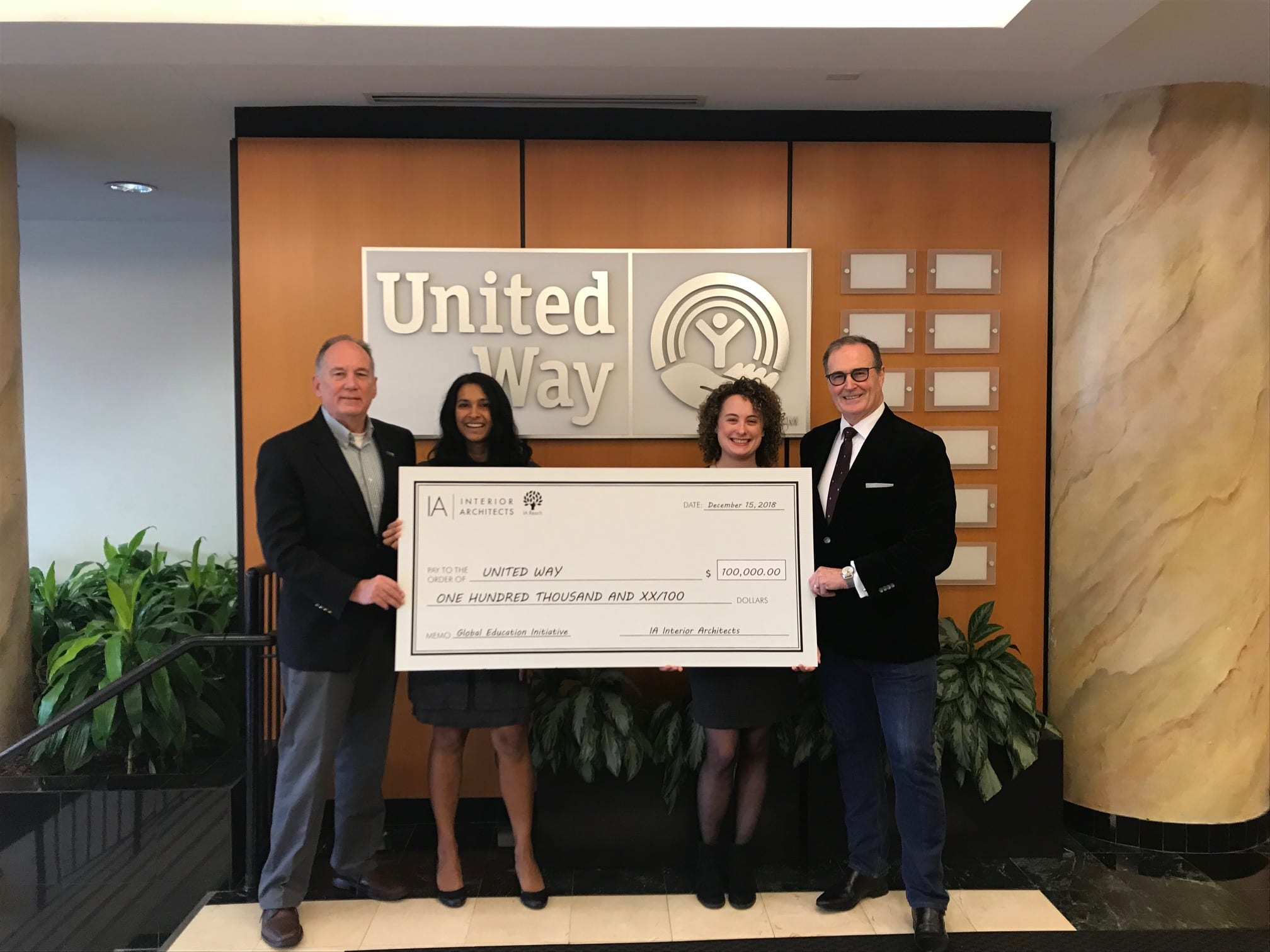 David Bourke presents the United Way With a Donation