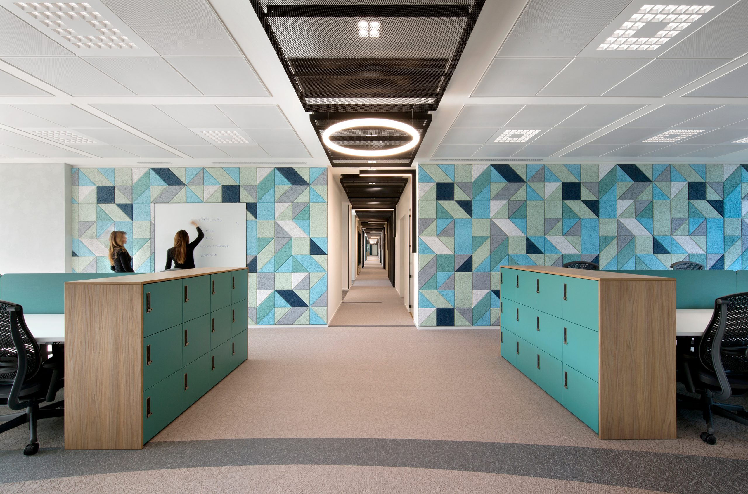 An open office in Italy using acoustic tiles
